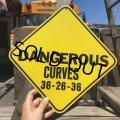 70s Vintage Cardboard Sign DENGEROUS CURVES (B292)